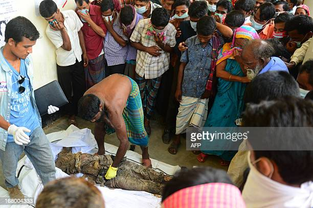 Relatives try to identify the body of a loved one killed in last week's building collapse in Savar, on the outskirts of Dhaka, on May 4, 2013. The...