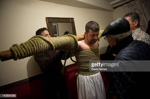 Relatives untie the rope to Feliciano Isaac aged 31 after walking the way of the cross or 'Via Crucis' at the end of the procession of the 'Empalaos'...