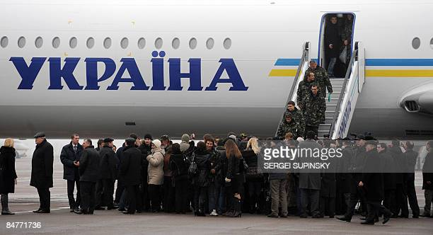 Relatives wait to meet sailors of crew member of a Ukrainian ship captured by Somali pirates after they arrived home at Kiev airport on February 13...