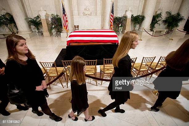 Relatives walk past the casket as they leave a private ceremony in the Great Hall of the Supreme Court where late Supreme Court Justice Antonin...