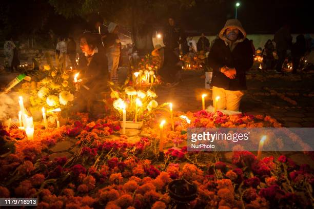 Relatives watch over their dead in the cemeteries of the Nahuatl community of San Isidro Buensuceso in the town of San Pablo del Monte to continue...