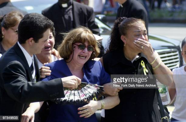 Relatives weep bitterly as they leave St Michael's Church in Brooklyn after the funeral of family killed by a car driven by an allegedlydrunk offduty...