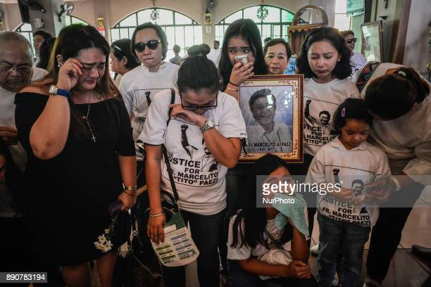 Relatives weep during the funeral of activist priest Fr Marcelito quotTitoquot Paez in San Jose Nueva Ecija north of Manila Philippines December 11...