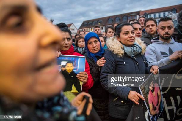 Relatives with the pictures of the victims attend a vigil near the Midnight shisha bar one of the sites of last night's shootings on February 20 2020...