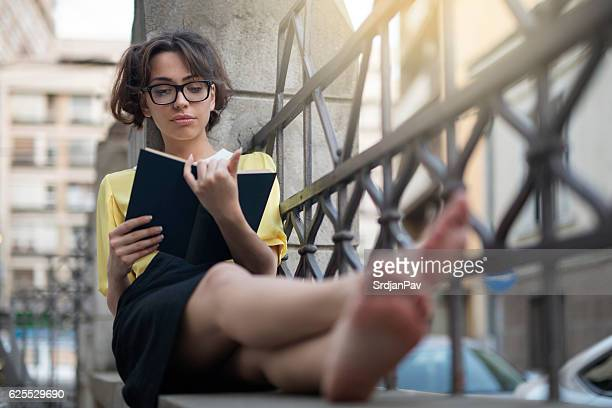 relax and enjoy reading - girl nerd hairstyles stock photos and pictures