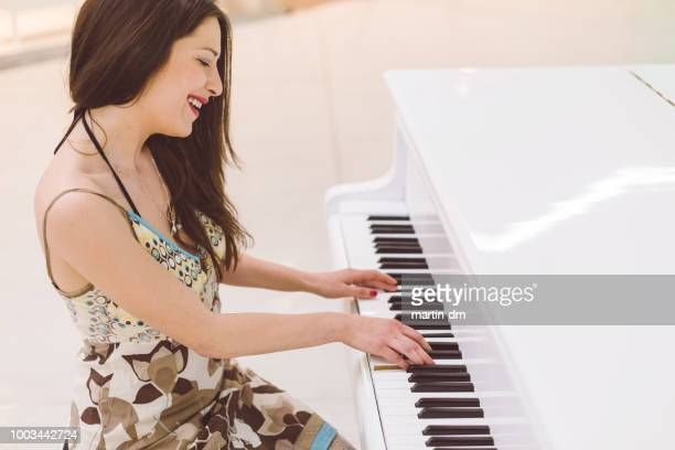relax and music - pianist stock photos and pictures
