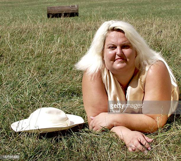 relax in the park - fat blonde women stock photos and pictures