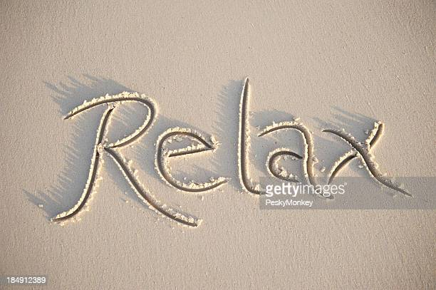 Relax Message Handwritten in Smooth Sand Beach with Soft Shadows