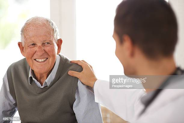 relax! you're in good hands - male doctor stock photos and pictures