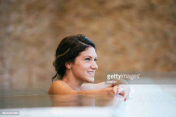 Relaxation and leisure time in swimming pool in spa