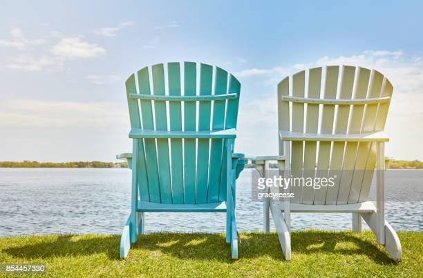 relaxation awaits - outdoor chair stock pictures, royalty-free photos & images