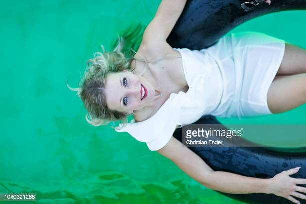 relaxation in a swimming pool - hot high school girls stock photos and pictures