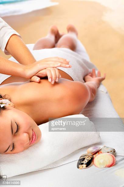 Relaxed African American woman enjoying in a Caribbean beach Spa