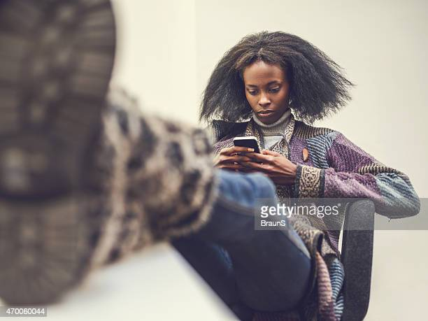 relaxed african american woman using mobile phone. - social justice concept stock pictures, royalty-free photos & images
