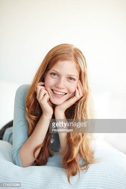 relaxed and casual at home - petite teen girl stock photos and pictures