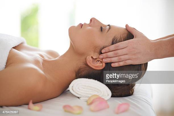 relaxed as can be! - head massage stock photos and pictures
