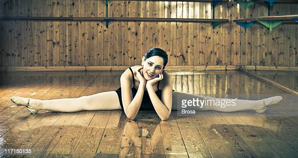 relaxed ballerina - woman open legs stock photos and pictures