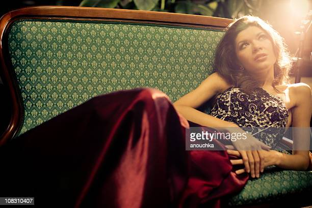 relaxed beautiful  woman resting in evening dress - one young woman only stock pictures, royalty-free photos & images