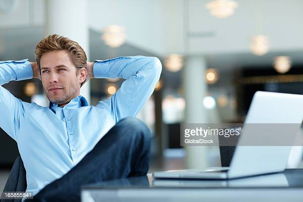 Relaxed business man thinking