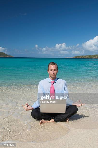 Relaxed Businessman Doing Yoga with Laptop Tropical Beach