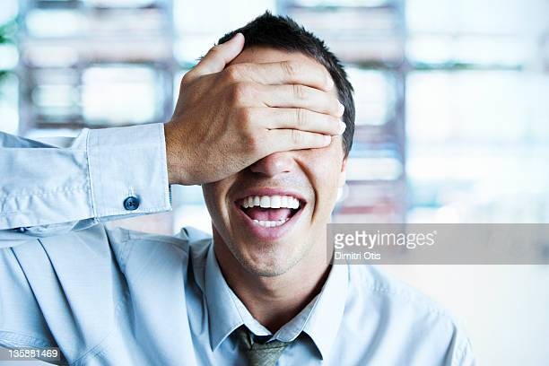 relaxed businessman masking his eyes with his hand - hands covering eyes stock pictures, royalty-free photos & images