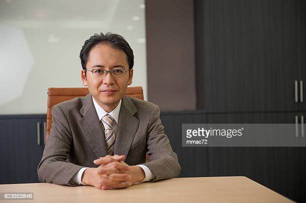 relaxed businessman - only japanese stock pictures, royalty-free photos & images