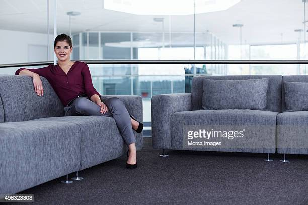 Relaxed businesswoman at office lobby