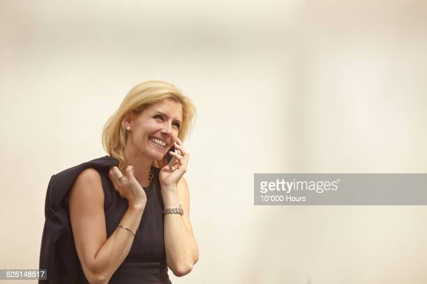 A relaxed businesswoman talking on mobile phone