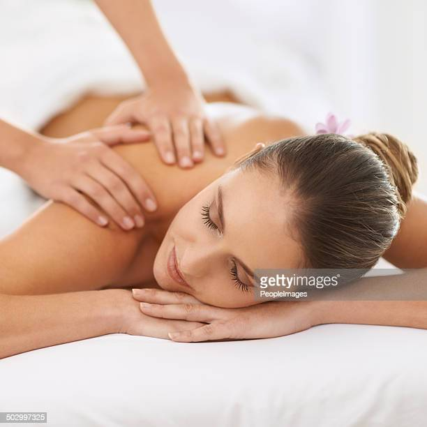 relaxed by magical hands - massage stock photos and pictures