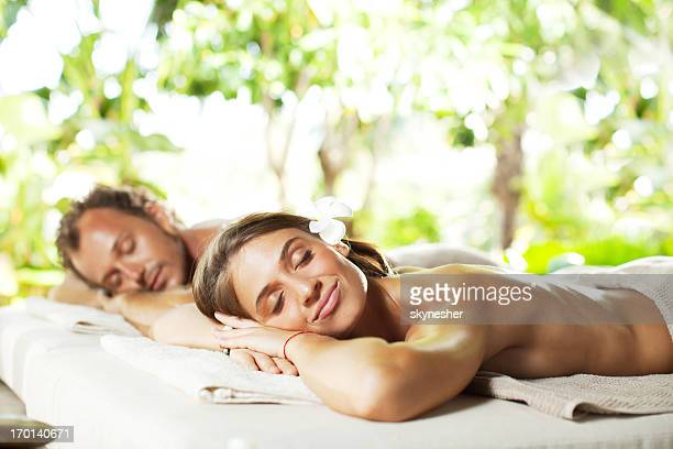 Relaxed couple on a massage.