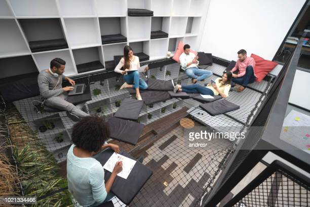 Relaxed designers working at a co-working space