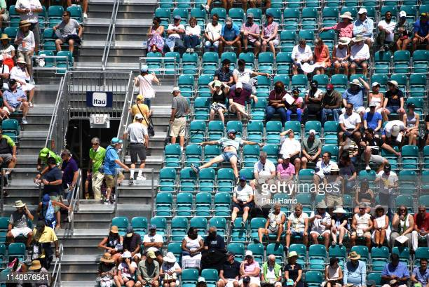 Relaxed fan of Simona Halep watches her play a match. 2019 is the first year that the Miami Open Tennis tournament was held at the Hard Rock Stadium,...