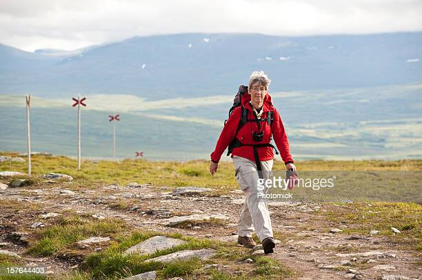 Relaxed female hiker with backpack