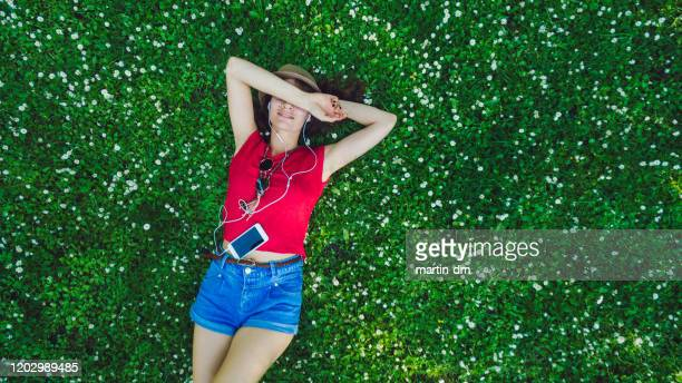 relaxed girl in the park - girls sunbathing stock pictures, royalty-free photos & images