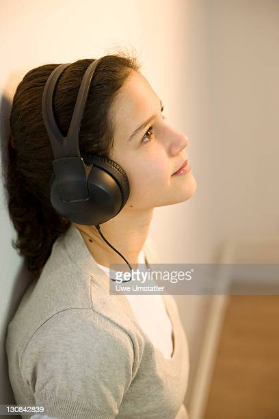 relaxed girl listening to music on headphones - 10 11 years stock photos and pictures