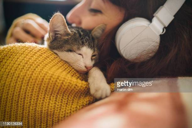 relaxed girl with cat at home - love emotion stock pictures, royalty-free photos & images