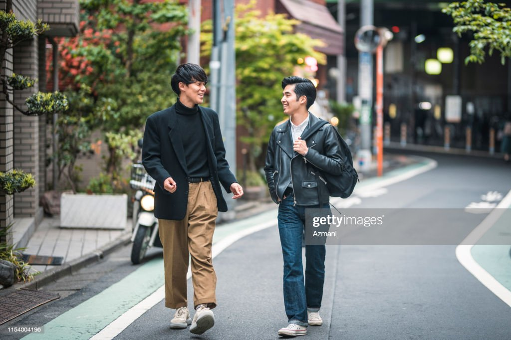 Relaxed Japanese Male Friends Walking and Talking in Tokyo : Stock Photo