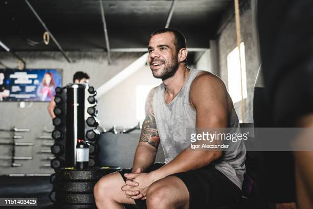 relaxed man at the gym - handsome bodybuilders stock pictures, royalty-free photos & images