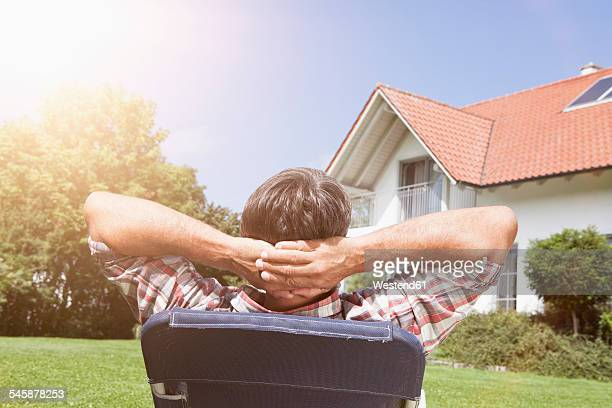 Relaxed man in deck chair in garden