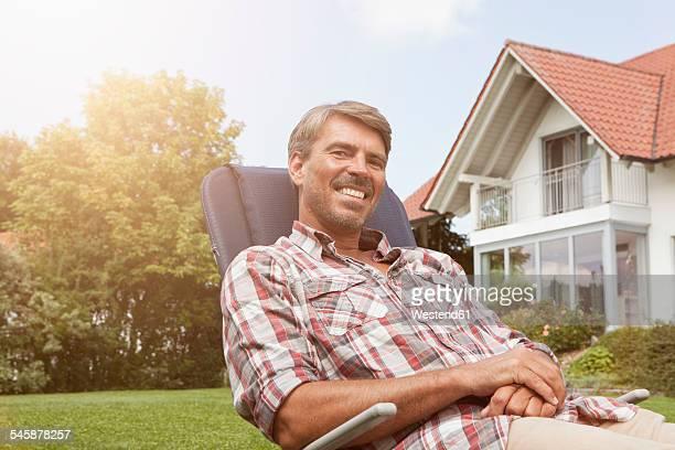 Relaxed man in deck chair in garden