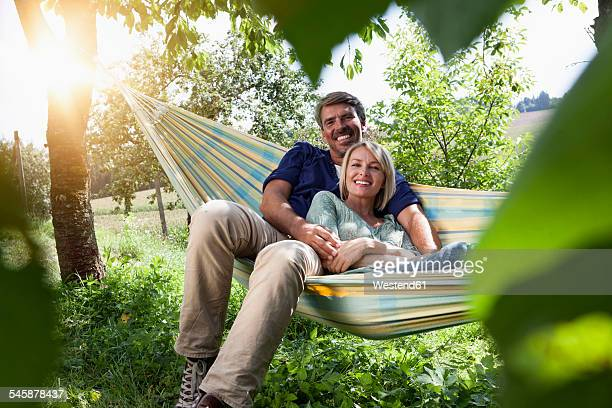 Relaxed mature couple in hammock
