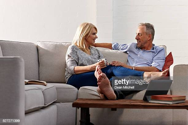 Relaxed mature couple sitting together on couch