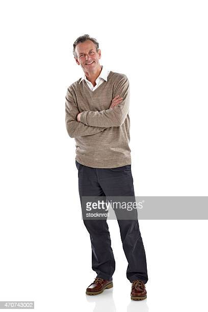 Relaxed mature guy standing over white