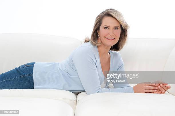 Relaxed Middle Age Woman on Couch at Camera Lifest
