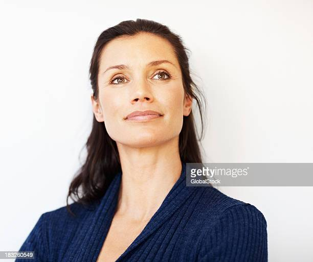 Relaxed middle aged woman looking away at copyspace