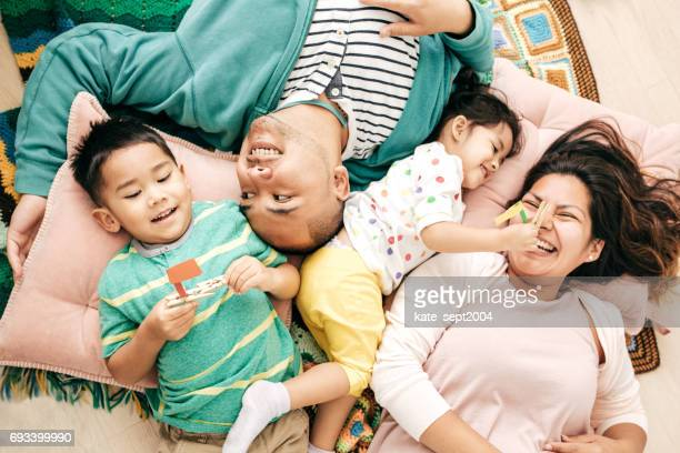 relaxed parenting - family at home stock photos and pictures