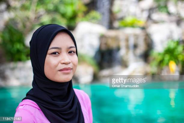 Relaxed portrait of Asian woman in hijab