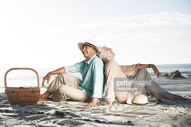 Relaxed senior couple on beach