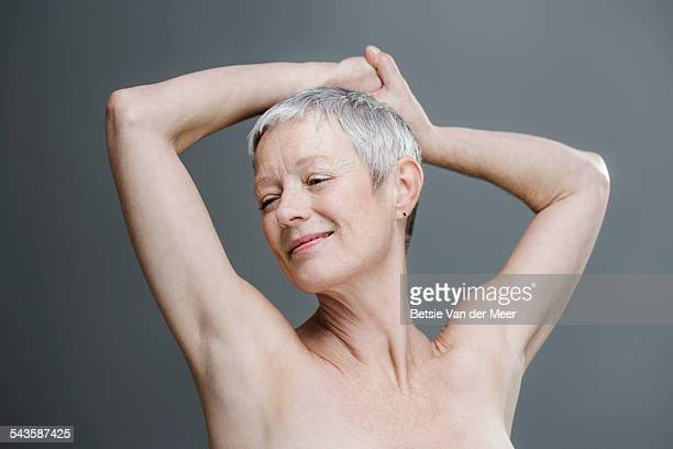 Relaxed senior woman with bare shoulders.