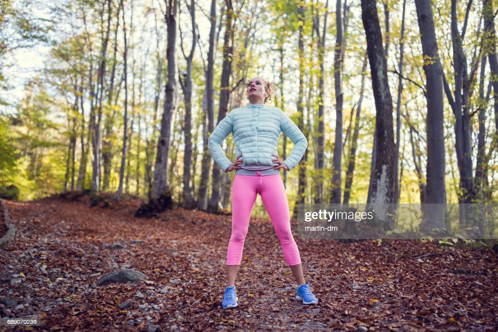 Relaxed sportswoman in the forest : Stock Photo